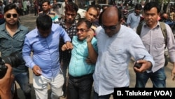 An opposition BNP activist is being arrested by plainclothes policemen in Dhaka. In 2018, thousands of opposition leaders and activists were arrested in Bangladesh on allegedly trumped up cases of political violence.