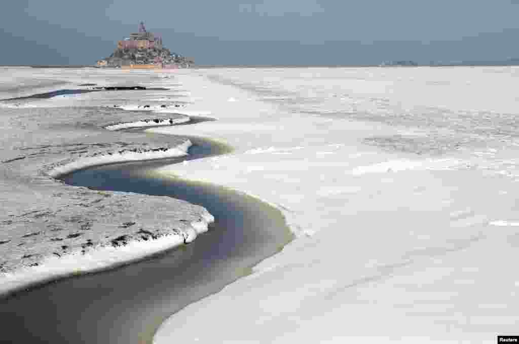 The snow-covered Bay of Mont Saint-Michel in the French western region of Normandy is seen as winter weather with snow and cold temperatures hits a large northern part of the country.