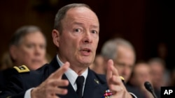 FILE - National Security Agency (NSA) Director Gen. Keith Alexander testifies on Capitol Hill in Washington, Dec. 11, 2013.