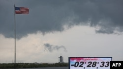 Ominous weather is seen above launch pad 39A at Cape Canaveral as the countdown clock continues on launch day at the Kennedy Space Center in Florida on May 27, 2020. - SpaceX's historic first crewed launch was set to proceed as scheduled Wednesday, NASA