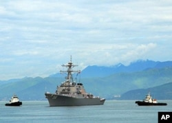 FILE - The guided-missile destroyer USS John S. McCain approaches Da Nang, Vietnam, May 7, 2019.