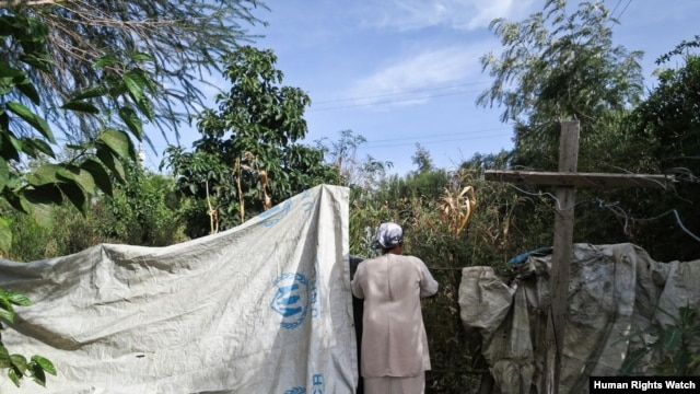 Maua E., 53, at her relocated home in Rift Valley. Maua went to a hospital for treatment two days after being gang raped but the health workers ridiculed her and delayed treatment.