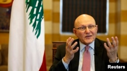 FILE - Lebanon's Prime Minister Tammam Salam speaks during an interview with Reuters in his office in Beirut, Nov. 12, 2014.