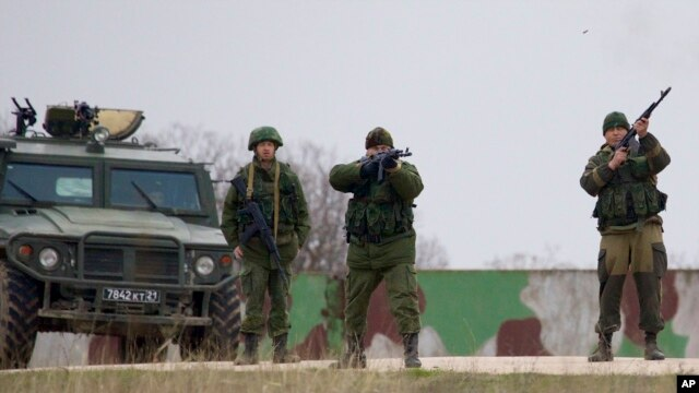 Russian soldiers fire warning shots at the Belbek air base, outside Sevastopol, Ukraine, March 4, 2014.