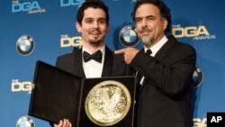 "Damien Chazelle, left, director of ""La La Land,"" celebrates his Feature Film Award win with presenter Alejandro Gonzalez Inarritu backstage at the 69th Annual Directors Guild of America Awards at the Beverly Hilton, Feb. 4, 2017, in Beverly Hills, Calif."
