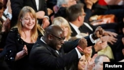 """British director and producer of """"12 Years A Slave"""" celebrates after being awarded best picture at the 86th Academy Awards in Hollywood, CA, March 2, 2014."""