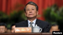 FILE - Ling Zhengce, deputy chairman of the Shanxi branch of the Chinese People's Political Consultative Conference (CPPCC), attends a meeting in Taiyuan, Shanxi province, China, Jan. 22, 2013.