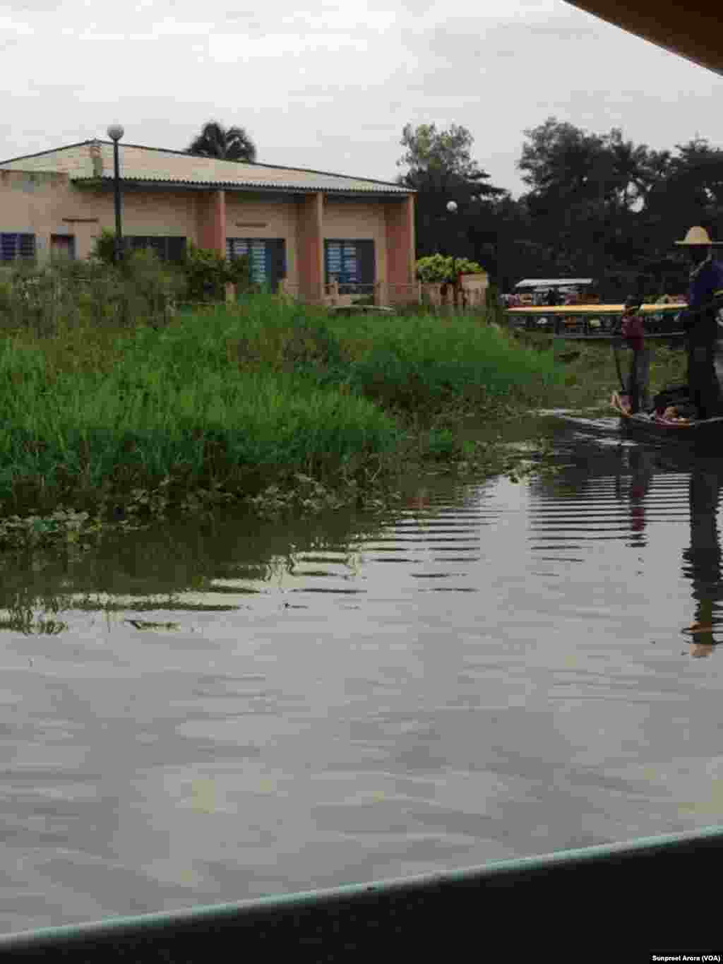 Boats approach a remote village where Michigan State University researchers test a fingerprint recognition system on infants and toddlers, Benin, Africa. (Sunpreet Arora)