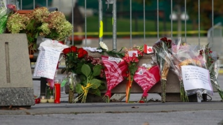 Flowers, momentos and well wishes are placed at the National War Memorial in downtown Ottawa, Oct. 23, 2014.