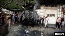 Vụ nổ khiến ít nhất 2 người bị thương và phá hủy ít nhất 5 chiếc xe của phe Hamas và của các phần tử Thánh chiến Hồi giáo tại Gaza City, ngày 19/7/2015.