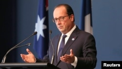 France's President Francois Hollande delivers an address at the National Gallery of Australia in Canberra, Nov. 19, 2014.