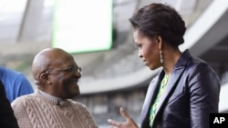 First lady Michelle Obama meets with Archbishop Desmond Tutu at Cape Town Stadium in Cape Town, South Africa, June 23, 2011.