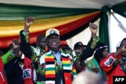 Zimbabwe's President Emmerson Mnangagwa addresses a rally in Bulawayo on June 23, 2018.