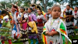 FILE - Bobby Morris, 4, of Wisconsin Dells, Wis., joins hundreds of other dancers at the Prairie Island Dakota Wacipi Celebration Pow Wow hosted by the Prairie Island Indian Community near Red Wing., Minn., on July 11, 2003.