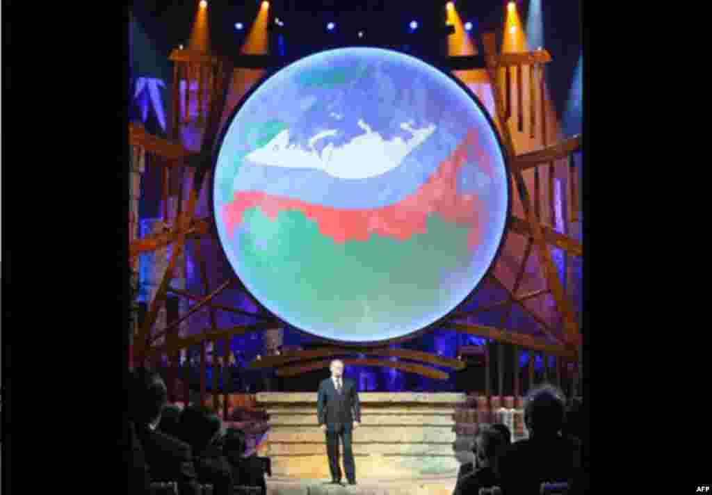 Russian Prime Minister Vladimir Putin speaks before a rock concert dedicated to tiger conservation in St. Petersburg, Russia, Tuesday, Nov. 23, 2010. Officials from the 13 countries where tigers live in the wild have signed a declaration aimed at saving t