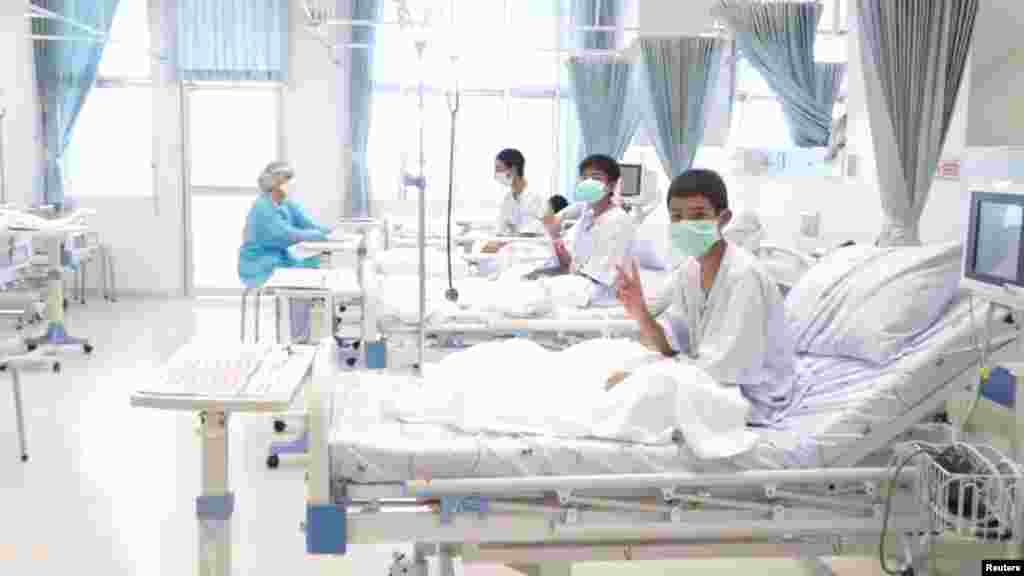 A screen grab shows boys rescued from the Thai cave wearing mask and resting in a hospital in Chiang Rai, Thailand. (Credit: Government Public Relations Department (PRD) and Government Spokesman Bureau)