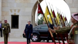 British Prime Minister Theresa May arrives to meet King Abdullah at the Royal Palace in Amman, Jordan during her visit to the Middle East, Nov. 30, 2017.