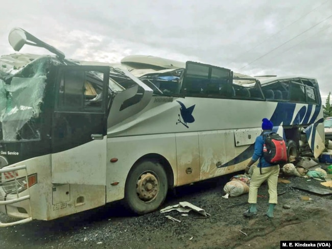 FILE - A bus burned by separatists in Akum, Cameroon, Sept. 9, 2018.