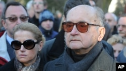 FILE - Poland's last communist leader Gen. Wojciech Jaruzelski, with daughter Monika, left, attend funeral ceremonies for Mieczyslaw Rakowski, in Warsaw, Poland.