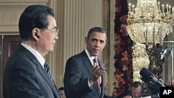 President Barack Obama gestures during his joint news conference with China's President Hu Jintao in the East Room of the White House in Washington, 19 Jan, 2011