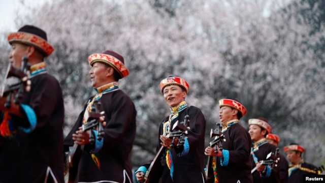 FILE - Tibetans play their traditional musical instruments to commemorate Serf Liberation Day in Nyingchi Prefecture, Tibet Autonomous Region, March 27, 2014.