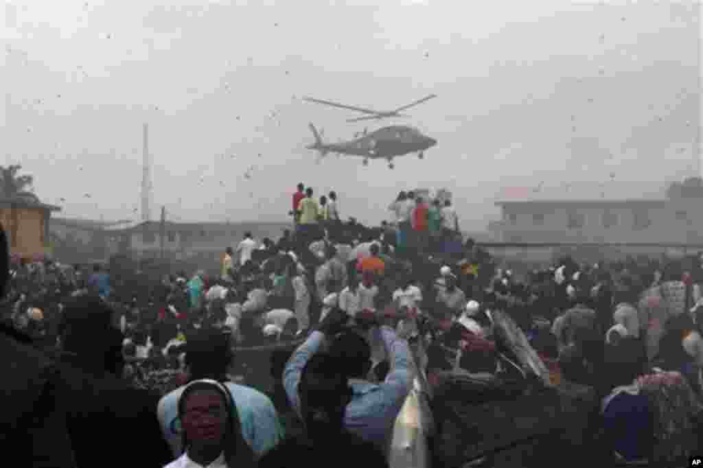 A helicopter flies over the site of a Dana Airlines plane crash in Lagos, Nigeria, Sunday, June 3, 2012.