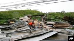 今年世界最強的第5類風暴星期天將登陸菲律賓。圖為2018年9月15日一次颱風過境菲律賓之後的災區景象。 (美聯社資料照)