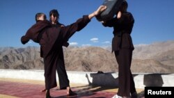 Buddhist nuns help a participant learn Kung Fu, a form of martial art, during a five-day workshop in Hemis region in Ladakh, India, August 17, 2017.
