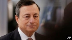 FILE - European Central Bank's President Mario Draghi.