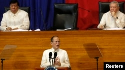 Philippine President Benigno Aquino (C) is seen delivering a speech at the House of Representatives in Quezon City, Manila, in this July 22, 2013, file photo.