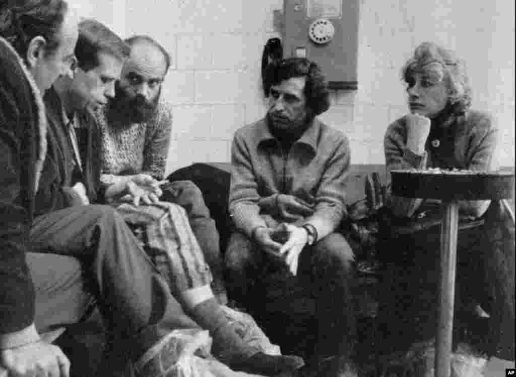 Havel's wife, Olga Havlova, when she visited him with his brother Ivan and other members of the Charta 77 disident movement Jiri, left, and Jan Ruml in a Prague hospital in February 1983. (AP)