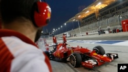 Ferrari driver Sebastian Vettel of Germany steers his car in the pits during the second free practice ahead of the Bahrain Formula One Grand Prix at the Formula One Bahrain International Circuit in Sakhir, Bahrain, April 17, 2015.