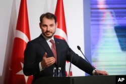 FILE - Berat Albayrak, Turkey's Treasury and Finance Minister, talks during a conference in Istanbul, Aug. 10, 2018, in a bid to ease investor concerns about Turkey's economic policy.