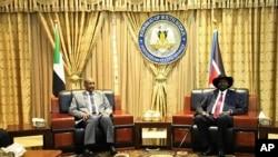 Gen. Abdel-Fattah Burhan, left, head of Sudan's sovereign council, meets with South Sudan's President Salva Kiir, in Juba, South Sudan, Oct. 14, 2019.