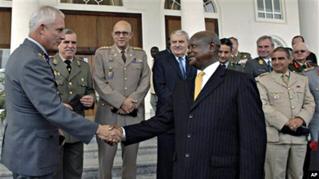 Uganda President Yoweri Museveni, right, greets European Union Military Committee Army Officers after a security meeting where they committed to support pacification of Somalia, at State House, Entebbe, Uganda, 04 Oct. 2010