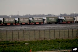 Some 150 trucks leave Manston Airfield during a 'no-deal' Brexit test for where 6,000 trucks could be parked at the former airfield near Ramsgate in south east England, Monday, Jan. 7, 2019.