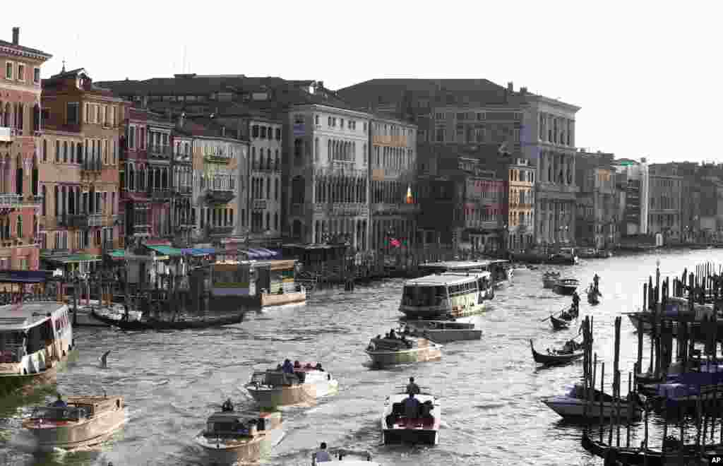 Boats sail past the Cavalli Palace, center left, as seen from the Rialto bridge in Venice, Italy. Venice city officials are closing a walkway fronting the picturesque Grand Canal on Sept. 29 to keep crowds away from George Clooney's wedding to human rights lawyer Amal Alamuddin.