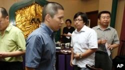 Luật sư Hứa Chí Vĩnh bị tố cáo khích động 5 vụ phản kháng ở Bắc Kinh hồi năm ngoái. Ông bị truy tố về tội gọi là 'tụ tập đông người, làm mất trật tự công cộng'.