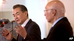 Chinese Foreign Minister Wang Yi, left, speaks during a meeting with Pakistan's Prime Minister's Adviser on Foreign Affairs Sartaj Aziz, in Islamabad, Pakistan, Feb. 12, 2015.