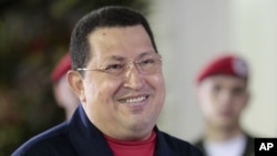 Venezuela's President Hugo Chavez smiles as he delivers a speech at Miraflores presidential palace in Caracas, Venezuela, June 4, 2012.