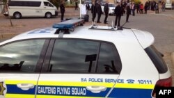 Photo courtesy of Eye Witness News (EWN) shows Gauteng Flying Squad vehicle waiting to escort Gupta wedding guests to Sun City, Waterkloof Airforce Base, near Pretoria, April 30, 2013.