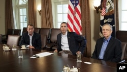 President Barack Obama meets with Senate Majority Leader Harry Reid, right, and House Speaker John Boehner, left, in the Cabinet Room of the White House, July 23, 2011