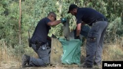 Israeli police inspect debris from what the military said was a Syrian drone that it shot down near the Sea of Galilee, in northern Israel July 11, 2018.