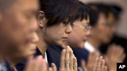 Cầu nguyện cho hành khách trên chuyến bay MH370.