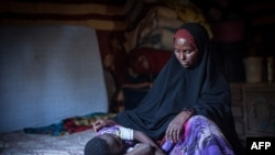 FILE — Amran Mahamood used to circumcise young girls in Hargeysa, Somalia, but stopped after a religious leader convinced her the rite was not required by Islamic law.