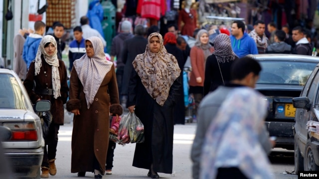 FILE - Women shop in the souq (market) of the old city in Tripoli, February 13, 2012.