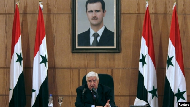 Syria's Foreign Minister Walid al-Moualem talks during a news conference in Damascus, Syria, Feb. 6, 2016.