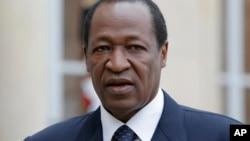 L'ancien président du Burkina Faso Blaise Compaoré à Paris avec François Hollande, le 18 septembre 2012.
