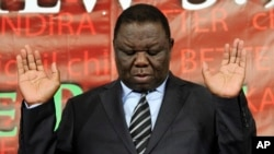 FILE: Zimbabwe's Prime Minister Morgan Tsvangirai attends a memorial service at a local church held to remember those killed during Zimbabwe's election violence, in Harare, Wednesday, April, 6, 2011. (AP Photo/Tsvangirayi Mukwazhi)