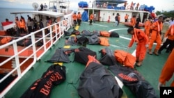 Body bags containing the bodies of the victims of a ferry that sank off Sulawesi Island last Saturday are laid on the deck of a rescue ship in the Gulf of Bone, Indonesia, Dec. 24, 2015.